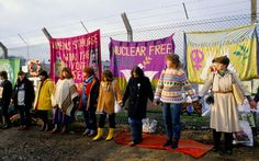 Peace protesters hold hands encircle perimeter fence, Greenham Common Berkshire England. 1983