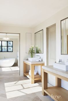 In the master bathroom, Linsteadt designed matching vanities, which are constructed from white oak. The wall-mounted faucet is by Dornbracht, and the floor's limestone pavers are from Exquisite Surfaces.