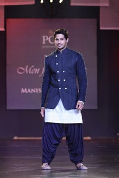 Usually at a Manish Malhotra show, the last thing we would look at are the men around (With so much gorgeous bridal drool around , who notices the men? At this Men for Mijwan fashion show however, o. Wedding Kurta For Men, Wedding Sherwani, Wedding Men, Wedding Suits, Wedding Dress, Mens Ethnic Wear, Indian Men Fashion, Ethnic Fashion, Boy Fashion
