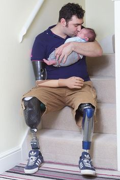Triple amputee war hero Any Reid with his newborn son William. hearing/seeing heroes/peopleinuniform give me chills. i do not think i will ever be able to express the depth of my gratitude. Real Hero, My Hero, My Champion, Wounded Warrior, Support Our Troops, American Pride, Faith In Humanity, Way Of Life, Good People