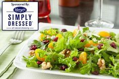 Simply Dressed® Mixed Greens with Manchego Cheese and Pomegranate Dressing