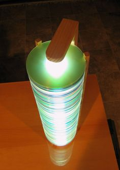 Stack them up to make this cool lamp. | 18 Cool DIY Ways To Use Your Old CDs