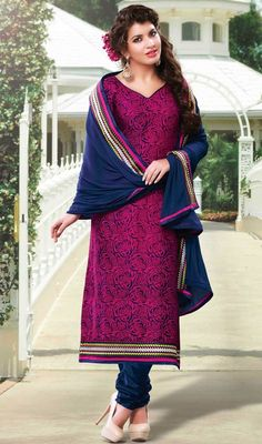 Mesmerize the party with your gleaming beauty dolled up in this navy blue cotton printed churidar suit. This attractive attire is displaying some fantastic embroidery done with block print, lace and resham work. #SexyFushiaPinkEmbroidredDress