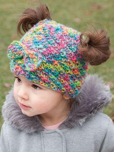 https://www.anniescatalog.com/detail.html?prod_id=135348 Messy Bun & Pigtail Knit Hat Annie's Signature Designs