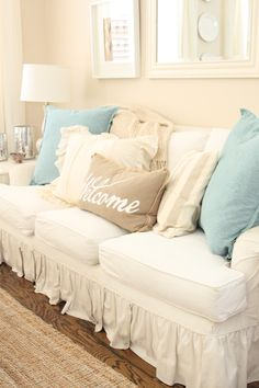 Coastal Living Room: Slipcovered Sofa with Burlap Pillows and Soft accents | Starfish Cottage