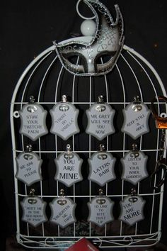Decor for my 50 shades of PLAY party.  Famous quotes from the book as well as small metal silver masks at the top of each quote