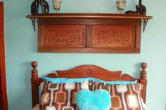 Old Piano remnants made into an art piece above the bed   I recycled some remnants of a very old piano that belonged to a friends grandmother... It had been at rest in his Shed for years and thank goodness he thought of me before it ended up on the burn pile... He said he had been saving it just because it look so neat with all the carved wood but decided he wanted to clean up his shed & was doing some tossing out... When he told me what he had I never imagined how beautiful it would be when