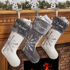 LOVE these shimmering snowflake personalized Christmas Stockings. The Ivory and Grey embroidered stockings look so beautiful together!