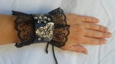 Black leather, lace cuff bracelet, 2 metal flowers with rhinestone rivets and corset tie