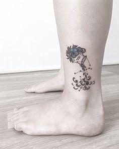Aquarius Water Bearer Tattoo   Tattoo Ideas and Inspiration Tattoo On, Piercing Tattoo, Body Art Tattoos, Aquarious Tattoo, Cover Up Tattoos For Women, Tattoo Catalog, Aquarius Constellation Tattoo, Tattoo Designs Wrist, Plant Tattoo
