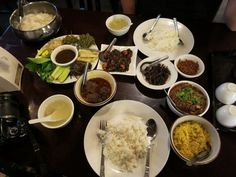 Myanmar curry, served with a selection of side dishes