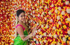 South Indian bride. Diamond Indian bridal jewelry. Jhumkis.Green kanchipuram sari with contrast pink blouse.Braid with fresh jasmine flowers. Tamil bride. Telugu bride. Kannada bride. Hindu bride. Malayalee bride.Kerala bride.South Indian wedding