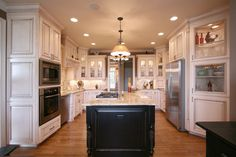 A French Country custom kitchen!  Let Walker Woodworking build your dream cabinets! Give us a call @ 704-434-0823 or visit us @ www.walker-woodworking.com !