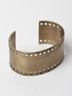 35mm film strip cuff.  I NEED this! Why are you sold out!?!