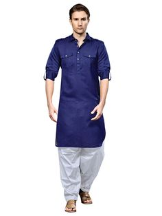 Get the new look with this Pathani Suit. Navy Blue Pathani kurta made from Cotton Silk fabric is decorated with fancy buttons and chest pockets. Paired with contrast White bottom. Pathani Suit Men, Pathani Kurta, Kurta Pajama Men, Kurta Men, Kids Kurta, Indian Men Fashion, Mens Fashion Wear, Men's Fashion, Boys Kurta Design