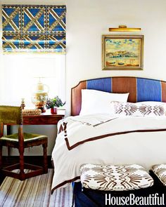 Masculine bedroom with ethnic textiles and vintage desk chair