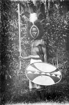 """Africa   """"Chagga warrior with spear, sword, buckler and club"""".  Tanzania.  ca. 1909 - 1914   ©Leipzig Mission; photographer likely to have been Ernst Hohlfeld"""