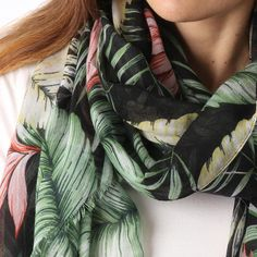 Ladies' Black scarf with multi colour leaf print, by Style Slice, features a decadent tropical pattern. Elegant spring or summer shawl that can be personalised with a charm or a monogram. Suitable as a gift for anniversary, birthday or any day in which to tell the woman in your life, be it a Mum, Wife, Sister or Girlfriend, that she is special. #scarf #shawl #wrap #scarves #fashion #vintage #handmade #acessories #etsy #gift #paradise #palmtree #headwrap #ootd #tropical