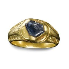 English, late 14th/15th century. Finger ring    engraved gold, set with a sapphire in hexagonal collet, inscribed: JOYE SANZ FYN (joy without end) on the interior. inside diameter: 1.8cm., 7/8 in. Est. 8,000—12,000 GBP. Sold 70,850 GBP    PROVENANCE: Found near St. Oswald's Church, Winwick, Cheshire