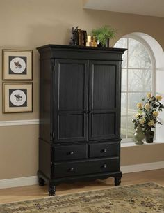 Black armoire-next project bathroom makeover! Would love to have this in it :-)