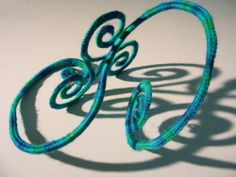 La Belle Helene: Shadow play  Crochet on wire with shadow interplay