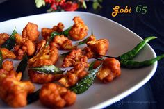 Gobi 65 is an extraordinary cauliflower (Gobi) dish which can challenge the chicken 65 and win the hearts of vegetarians and non-vegetarians alike. Gobi Recipes, Veg Recipes, Indian Food Recipes, Asian Recipes, Vegetarian Recipes, Snack Recipes, Cooking Recipes, Ethnic Recipes, Cooking Stuff