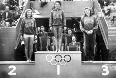 1948 Olympic Games. London, England. Springboard Diving. United States medal winning trio stand on the podium during the medals ceremony. L-R: P. Esner (silver), Vicky Draves (gold) and Z. Olsen (bronze).