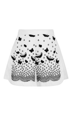 Short, sweet, romantic and ready for the after party: a definite festive sensibility permeates Giambattista Valli's sister line. These **Giamba** shorts exude whimsical chic in white broderie anglaise with black appliqué butterflies.