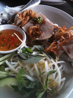 """""""Banh Cuon Cha Lua"""" - Rice rolls with pork loaf, beanshoot, shallots and mints"""