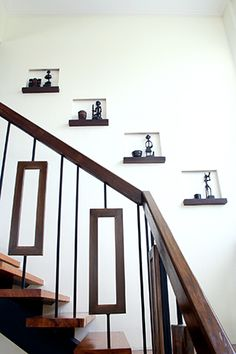 Steel rectangles, painted to look like wood, complement the lines made by the stair banisters. Nooks that hold trinkets %u2013 small baskets from Palawan and figurines from Benguet - line the stairway wall.