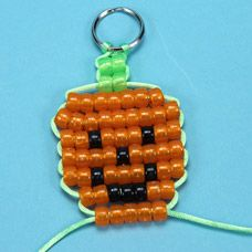 Step by step photo instructions on weaving pony beads together to make a Jack-O-Lantern Bead Pet