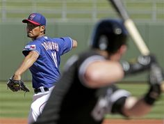 Texas Rangers starting pitcher Yu Darvish, of Japan, throws to Chicago White Sox's Gordon Beckham during a spring training baseball game Tuesday, Feb. 26, 2013, in Surprise, Ariz. (AP Photo/Charlie Riedel)
