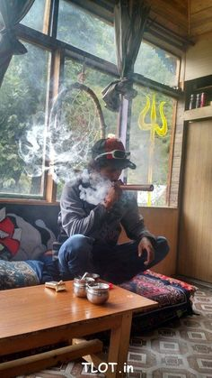A local chilling at a cafe in Kasol. #Kasol #Backpacking #Hash