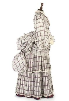 Purple and white checked organdy dress, ca. 1870s, with wide-sleeved bodice over a sleeveless blouse, and with elaborately draped double bustle. Christie's