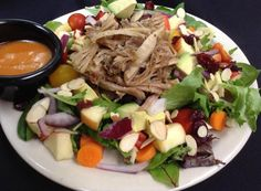 Wintertime Salad topped with our slow- roasted pork and served with our house vinaigrette :: Rolling Scones Bakery & Cafe located in Goshen, IN