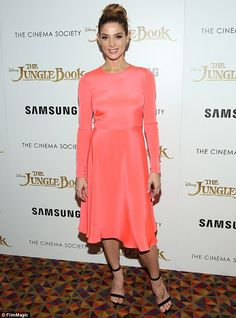 Incredible: Ashley Greene looked incredible in a peach hued flared frock in New York City ...