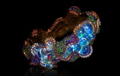 RHYTHM OF A FANTASY, WALLACE CHAN IT TELLS THE STORY OF A MERMAID, A COLORFUL WORLD UNDER WATER, AND A CHARIOT OF UNICORNS ACROSS THE RAINBOW… PIECES OF IMAGINATION INSPIRED BY A CHILDLIKE LOVE FOR NATURE AND THE WORLD. BANGLE – OPAL, TOPAZ, FANCY COLORED SAPPHIRE, DIAMOND