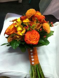 Fall Wedding bouquet, hate those sparkly flower buttons.