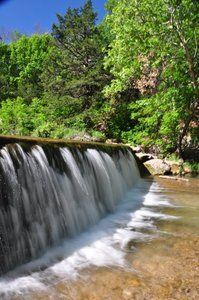 Chickasaw National Recreation Area in Sulphur, Oklahoma features spring-fed waters rippling over small waterfalls in the creeks that run through the park.