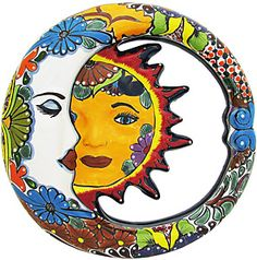 Handmade of clay in the classic Talavera style and then hand-painted with vibrant, eye-catching colors, this Talavera Eclipse mirror will add a touch of the Southwest to any decor. Each piece of Talavera wall art is made by skilled artisans outside of Dolores Hidalgo, Mexico, and personally chosen by the La Fuente team for its high quality and unique design. An eyelet located on the back of each mirror makes it perfect for hanging in both indoor and/or outdoor spaces. Mirror glass is…