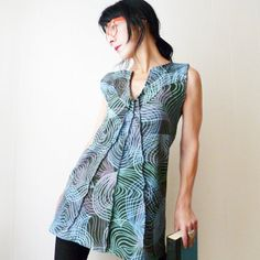 This unique tunic is handmade completely from scratch using fabric I hand printed with my original artwork. An original design and one of a kind.    I