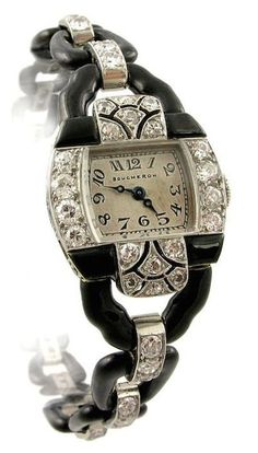 Boucheron Art Deco Diamond and Enamel Watch France 1925 An Art Deco handmade black enamel and diamond bracelet watch of graduating open link design, in platinum. Boucheron, Paris.