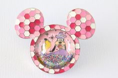 This Disney pin for sale features a bright pink Mickey head and ear shaped icon…