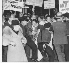 "This photo was taken at a rally of the United Anti-Nazi Conference outside the Los Angeles headquarters of the German American Bund. Police struggle to restrain the picketers. Visible signs read: ""Inside -- a Nazi convention! Outside -- an American protest!"" and ""United Anti-Nazi Conference.""  	Jewish Federation Council of Greater Los Angeles Collection."