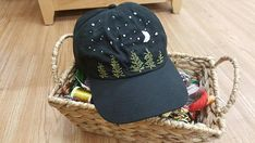 Embroidery Stitches Ideas A hand embroidered night scene on an adjustable hat. - A hand embroidered night scene on an adjustable hat. Hat Embroidery, Hand Embroidery Stitches, Embroidery Fashion, Hand Embroidery Designs, Embroidery Techniques, Cross Stitch Embroidery, Beginner Embroidery, Embroidery Ideas, Machine Embroidery