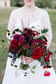 Dramatic Berry Tone Wedding Inspiration - wedding bouquet with greenery, deep red, purple and blue tones. #berrytones #weddingbouquet