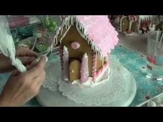 {Video} Making a Gingerbread House & {Free Printable} Gingerbread House Template--Great video on how to--key that I had been missing.  Let walls sit over night before adding roof and then let that sit another 12 hours before decorating.  The glue gun idea is getting to be more appealing all the time.