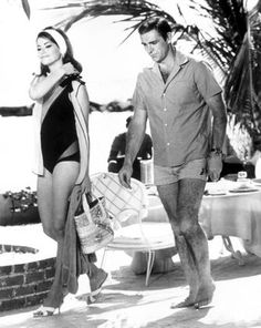 As James Bond, 007, pictured with co-star Claudine Auger a former Miss France during the filming of 'Thunderball' in Nassau, 1965.