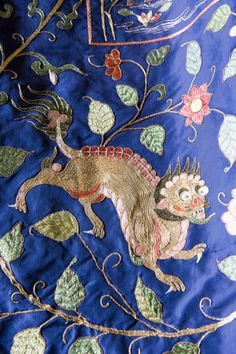 Qilin embroiderd onto the blue silk covers on the state bed at Calke. ©National Trust Images/John Millar
