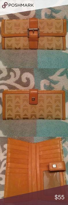 Never Used Vintage Michael Kors Wallet Authentic vintage Michael Kors wallet, beautiful signature canvas, leather trim, excellent condition. Michael Kors Bags Wallets
